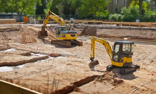 Earthmovers on excavation work