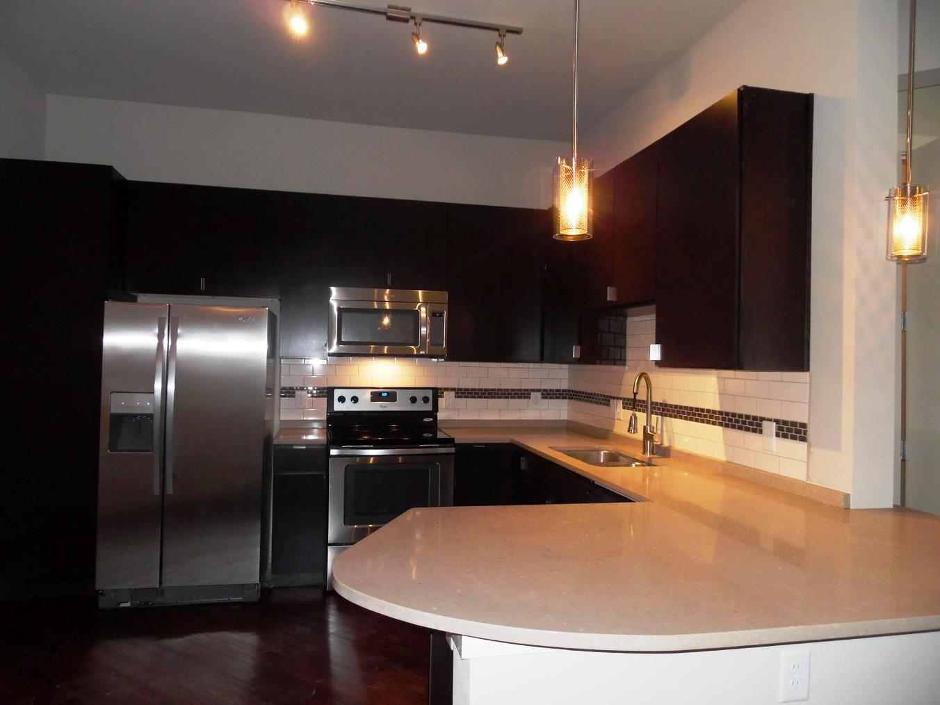 luxury apartment interior with stainless steel appliances - San Antonio TX - Apartments Today Inc.