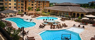 luxury apartment exterior during day with large pool - San Antonio TX - Apartments Today Inc.