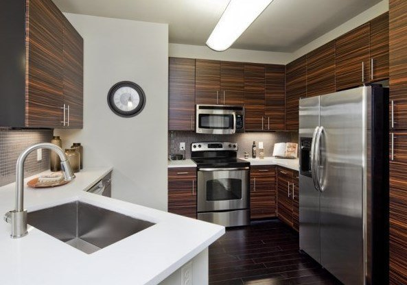 luxury apartment interior with white countertop and stainless steel appliances - San Antonio TX - Apartments Today Inc.