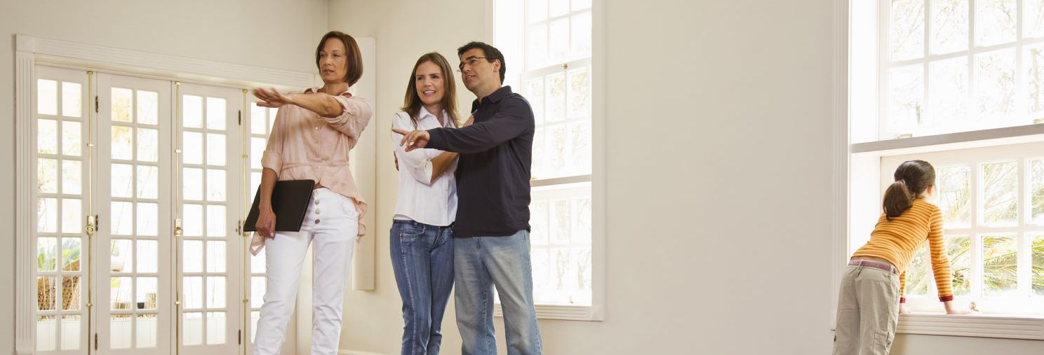 A property consultant showing couple around a house in Rodney Bay