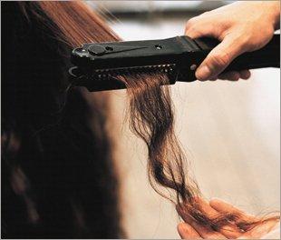 Long brown hair being straightened
