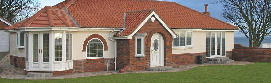 A large detached property with uPVC windows and doors