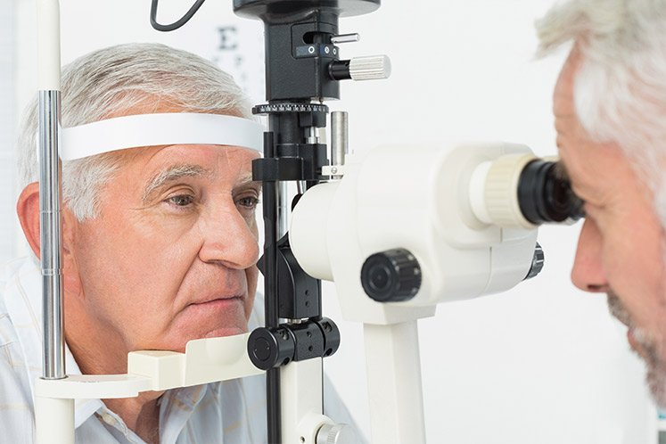 Elderly man closer by an expert optician near Prahran