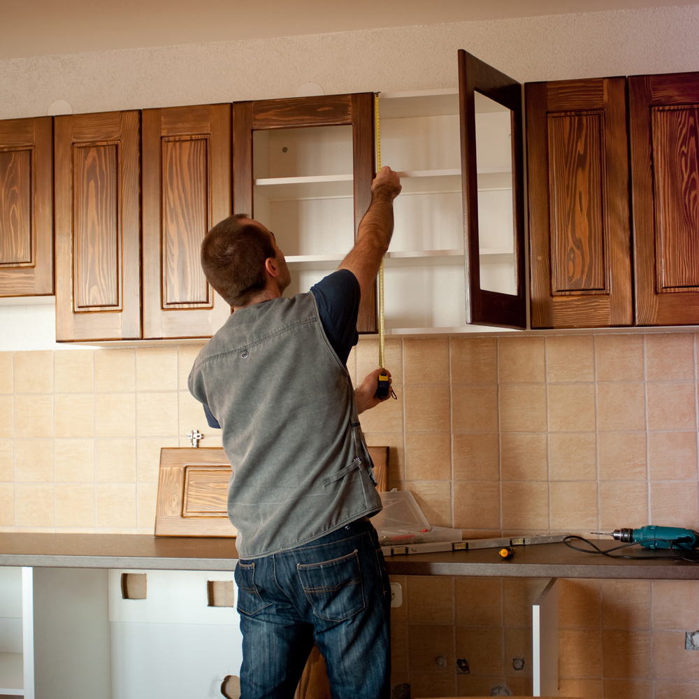 A worker installing a new kitchen