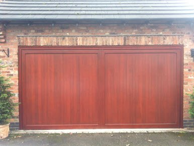 wooden garage door restored