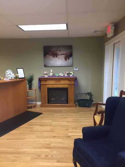 picture of waiting room facing fireplace