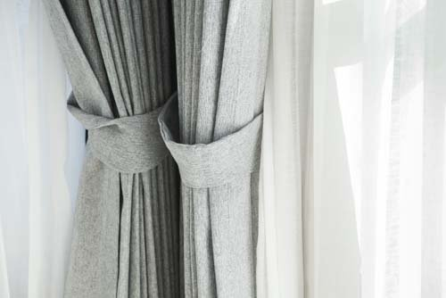 View of grey window curtain