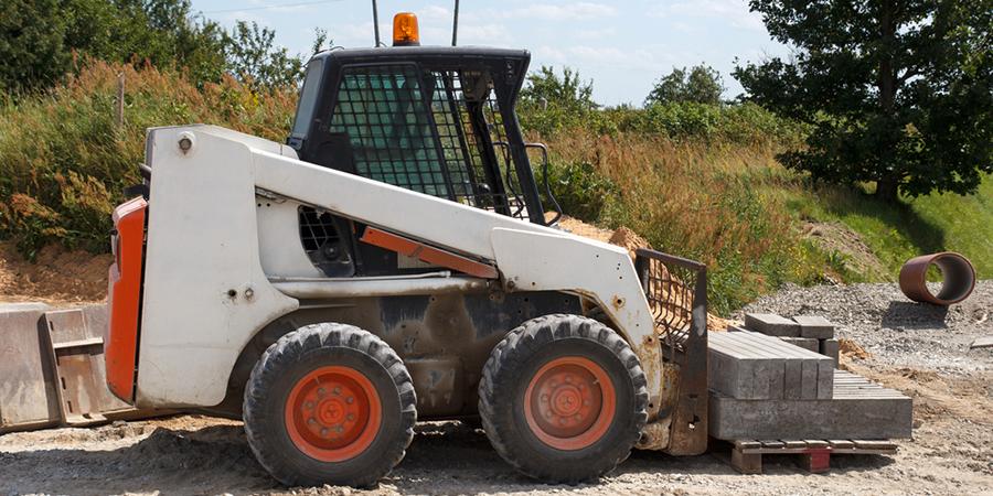Bobcat shovelling gravel