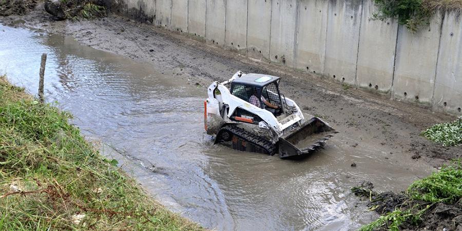 Excavator bobcat along river