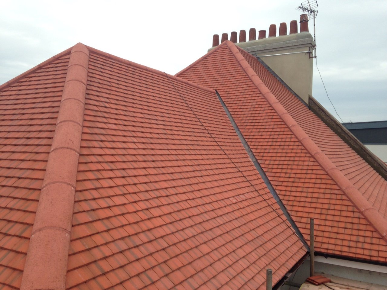 installation of a red tiled roof by Affordable Roofing Ltd in Devon