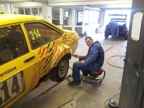 One of our team doing car body repairs