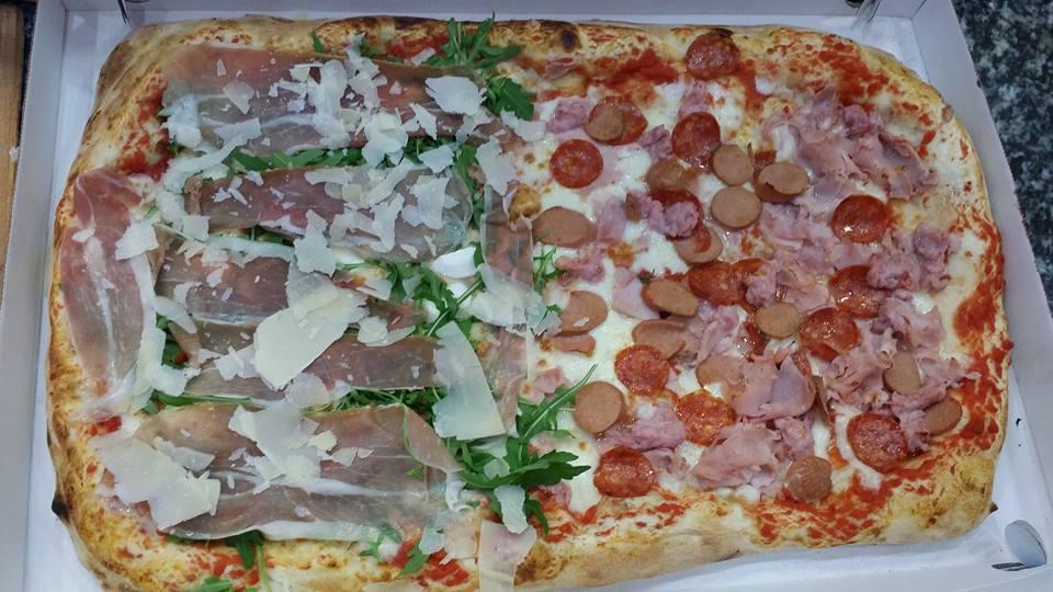Pizza gigante con prosciutto