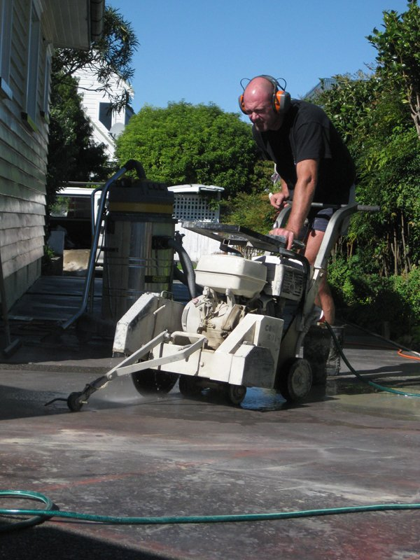 Expert giving finishing touches to the concrete floor