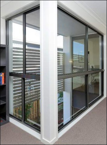 Sliding windows in an office in Canberra