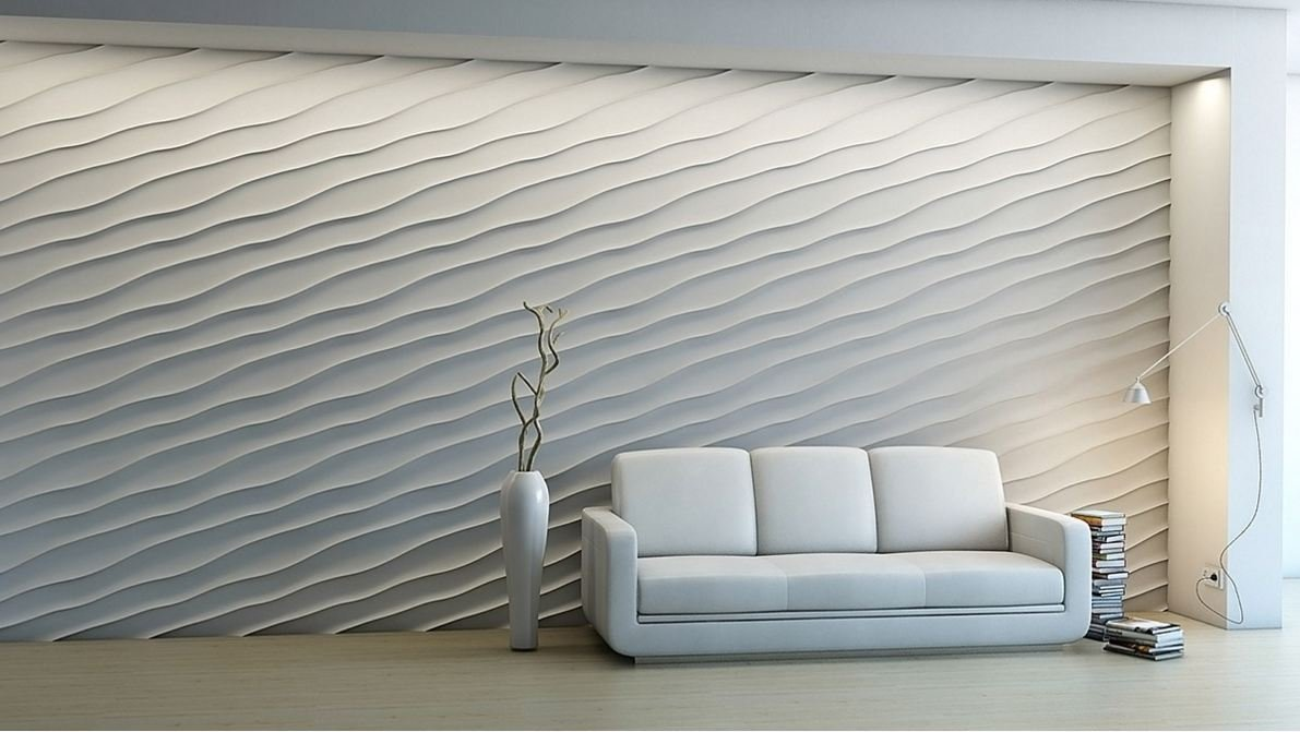 parete con rilievi ondulati e divano bianco