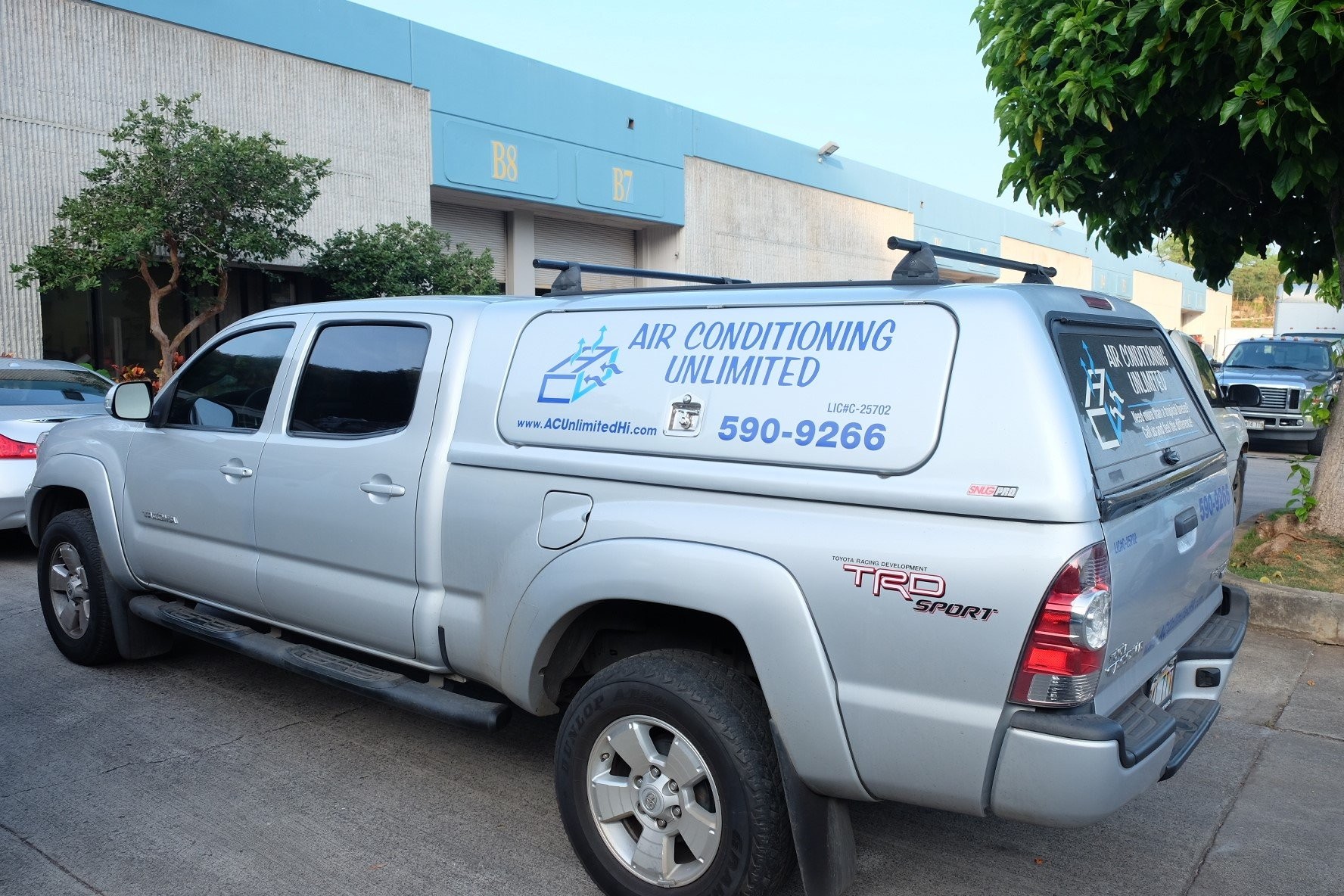 Air conditioning experts doing the repair in Aiea, HI