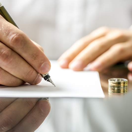 A client signing the divorce agreement