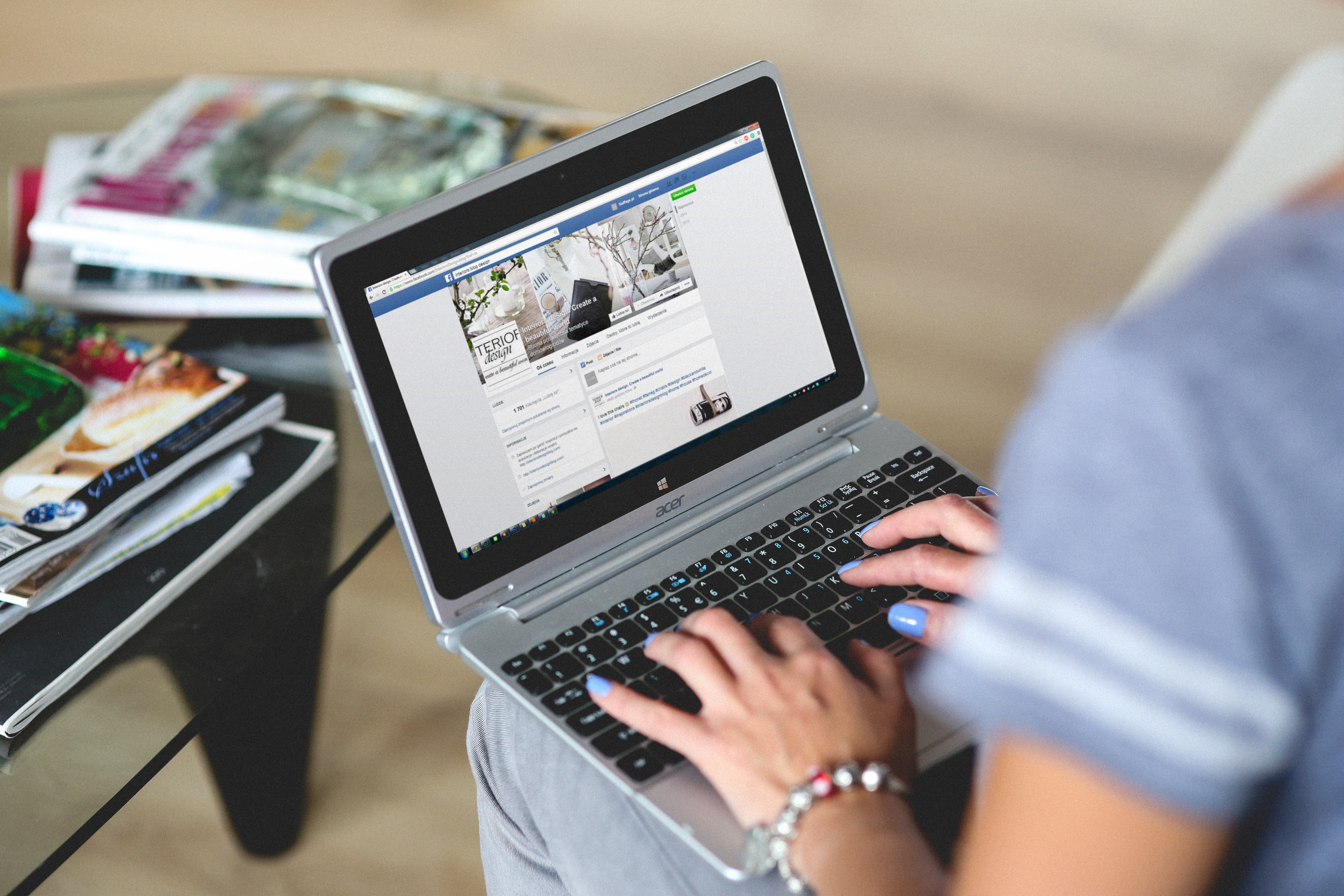a person searching on Facebook on her laptop
