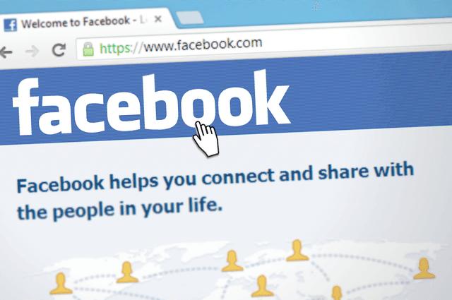 A cursor hovering over Facebook online