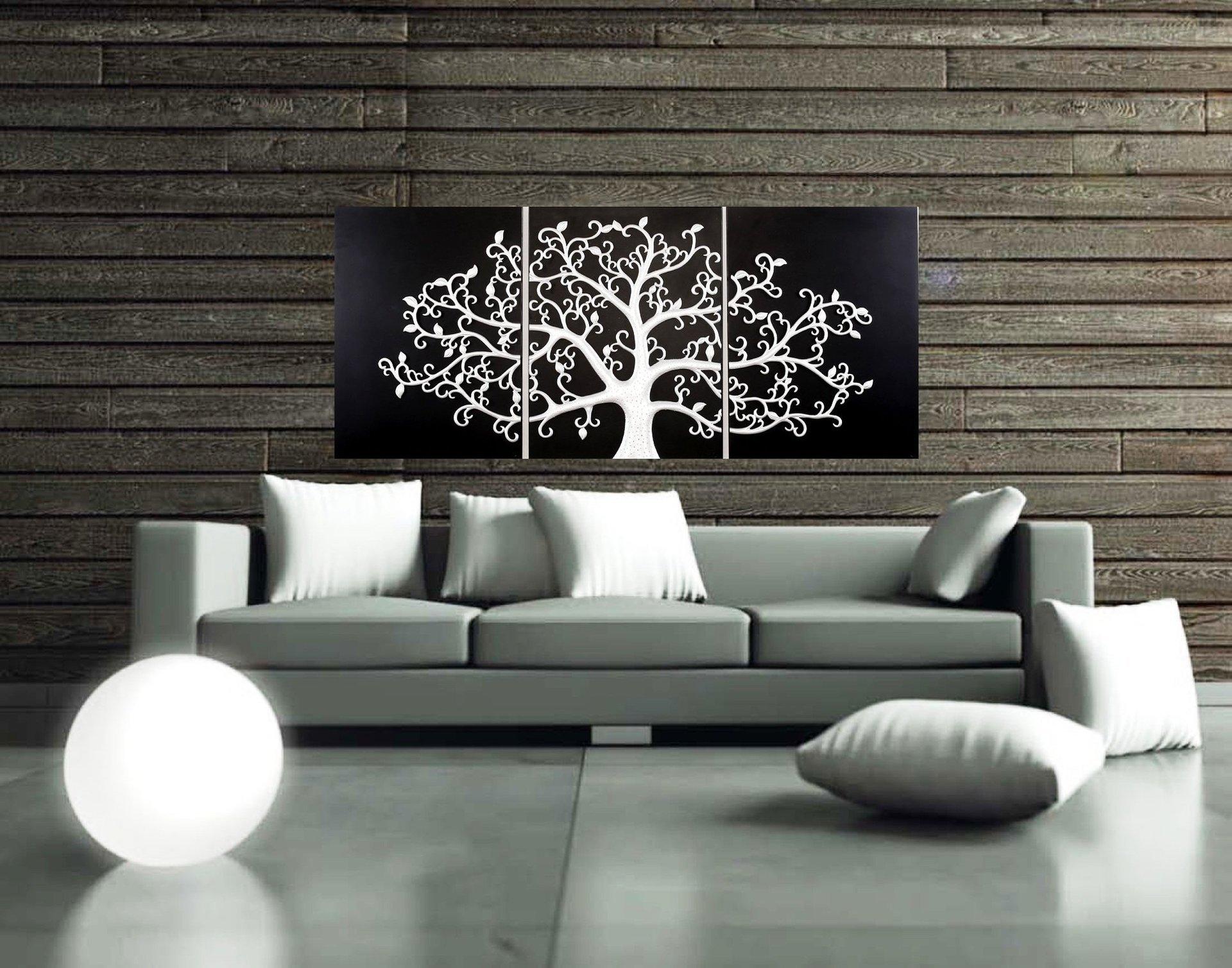 soggiorno con divano e quadro di un albero