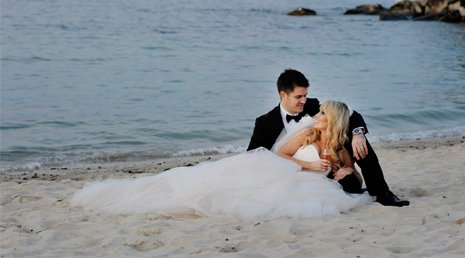 Couple lying on beach after their wedding