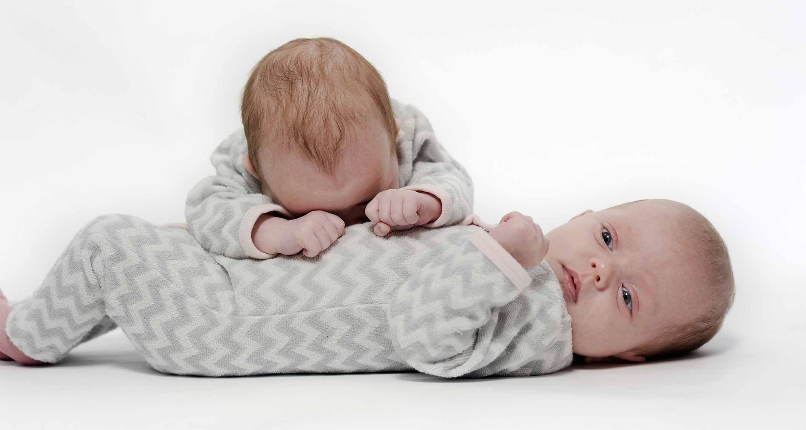 Portrait of babies playing