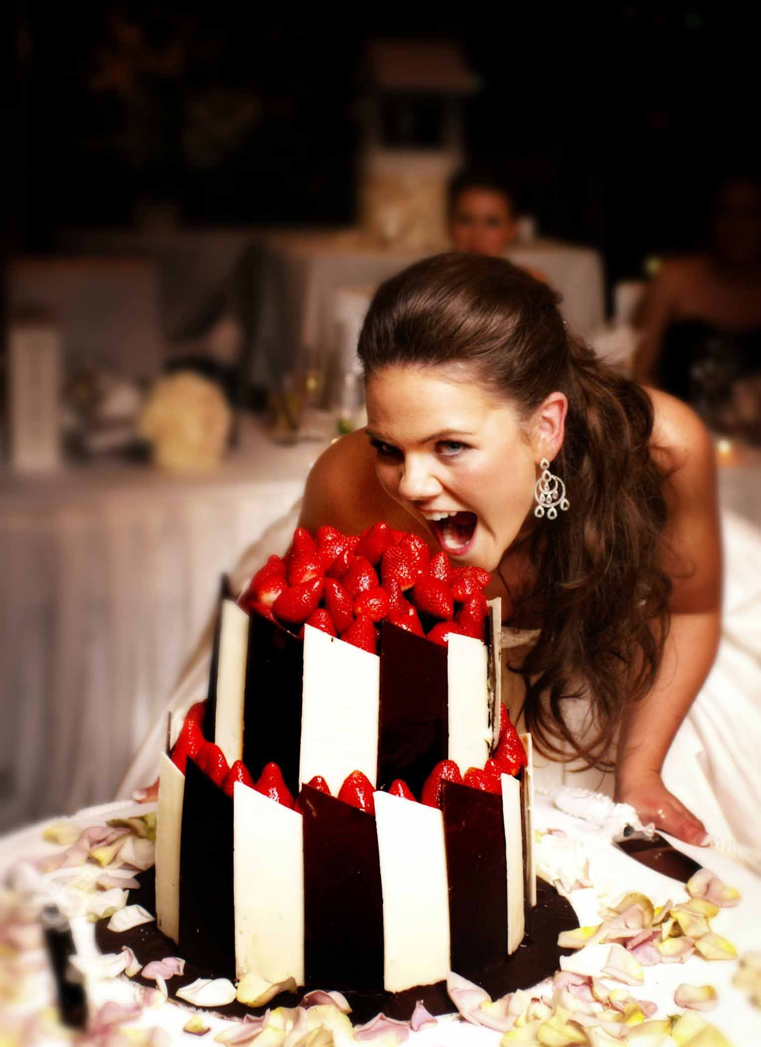 Bride with 2 layer wedding cake
