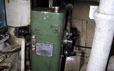 Woodward speed governor mounted on a generator