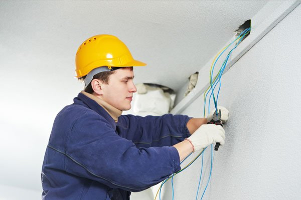 Male electrician at work
