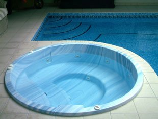 Swimming pool with yellow inflatable toy