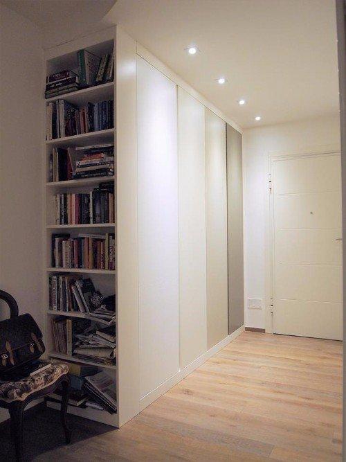 Libreria su misura e pavimento Parquet