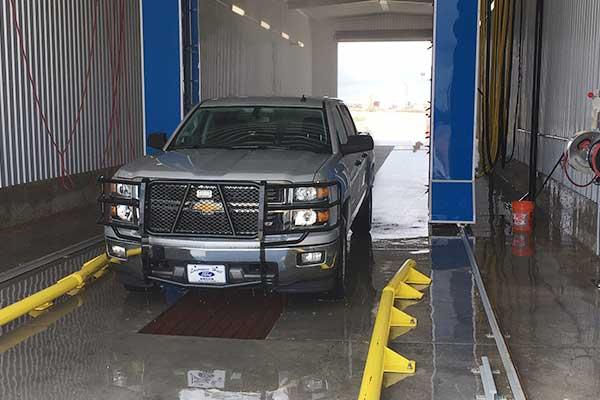 Car in a water servicing garage