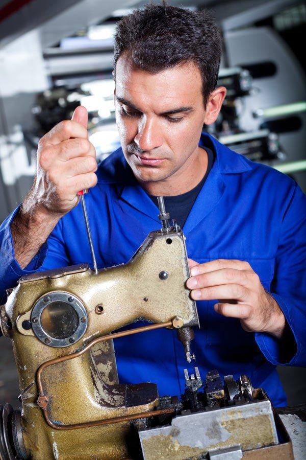 Expert repairing the sewing machine