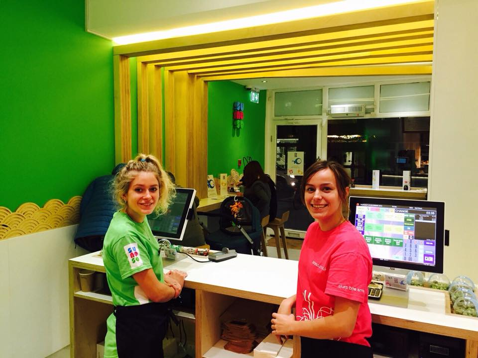 two girls operating EPOS systems