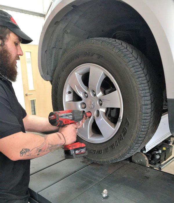 man putting back a wheel