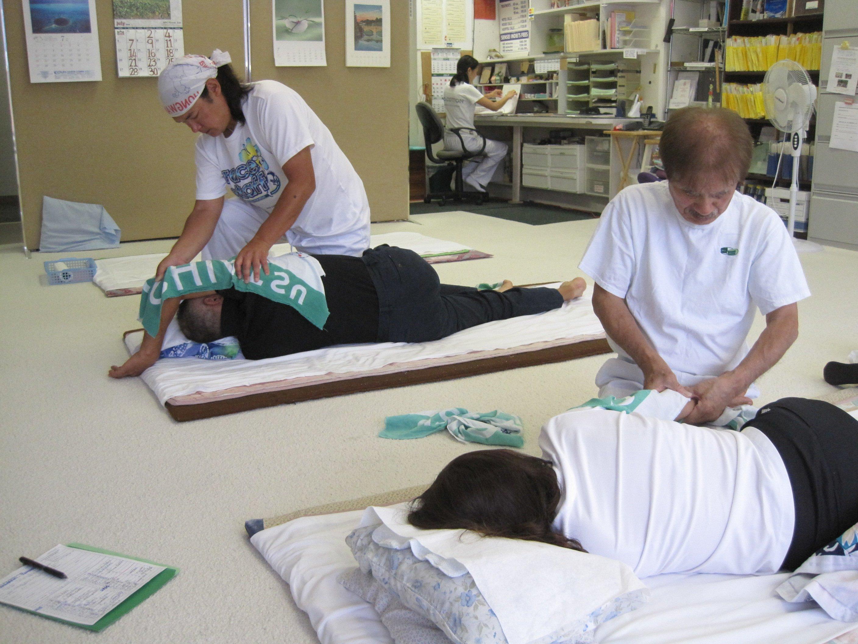 A man with closed eyes enjoying a Shiatsu massage