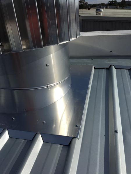 Top view of metal roof replacement  with air vent