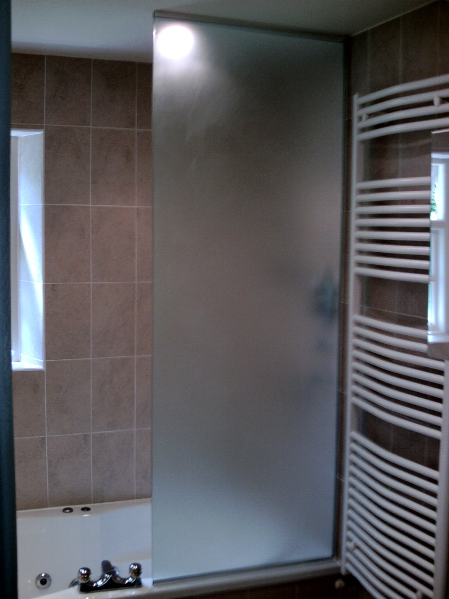 Glass fitting for showers