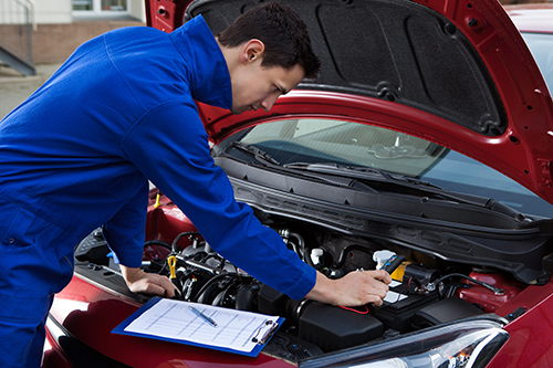 Professional checking the engine for repair in Banbury, OX