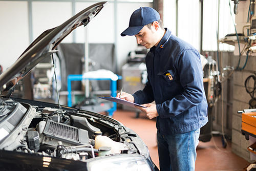 Professional checking car engine for repair in Banbury, OX