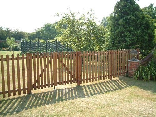 A picket fence on a grass court