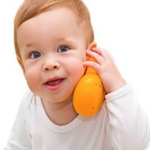 small boy playing with toy phone