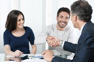 Divorce attorney shaking hand with parents