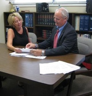 Social security & disability lawyer Scott Dunn helping a client in his law office in Asheboro, NC