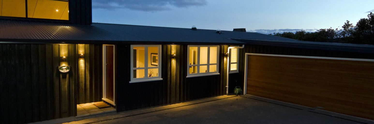 Nightfall over a house built by a master builder in Taupo