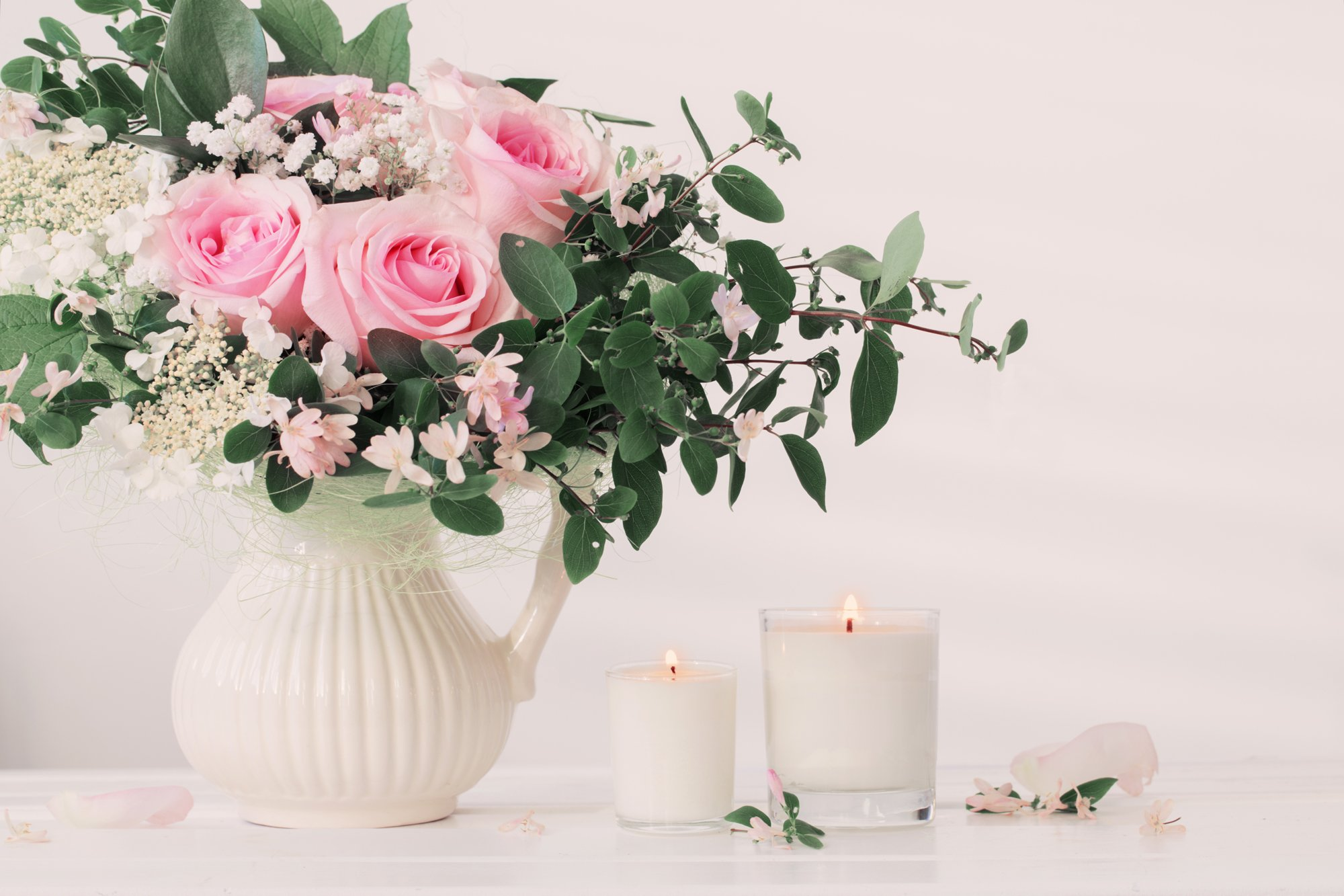 White flower vase with white scented candles