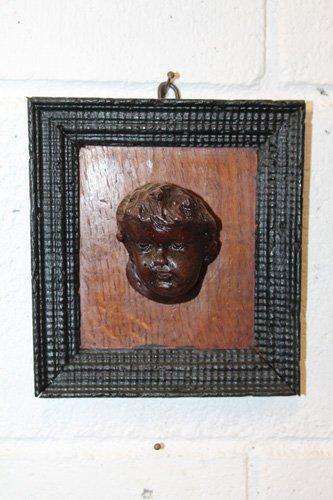 quadro appreso con attaccata la faccia in legno di gesu bambino