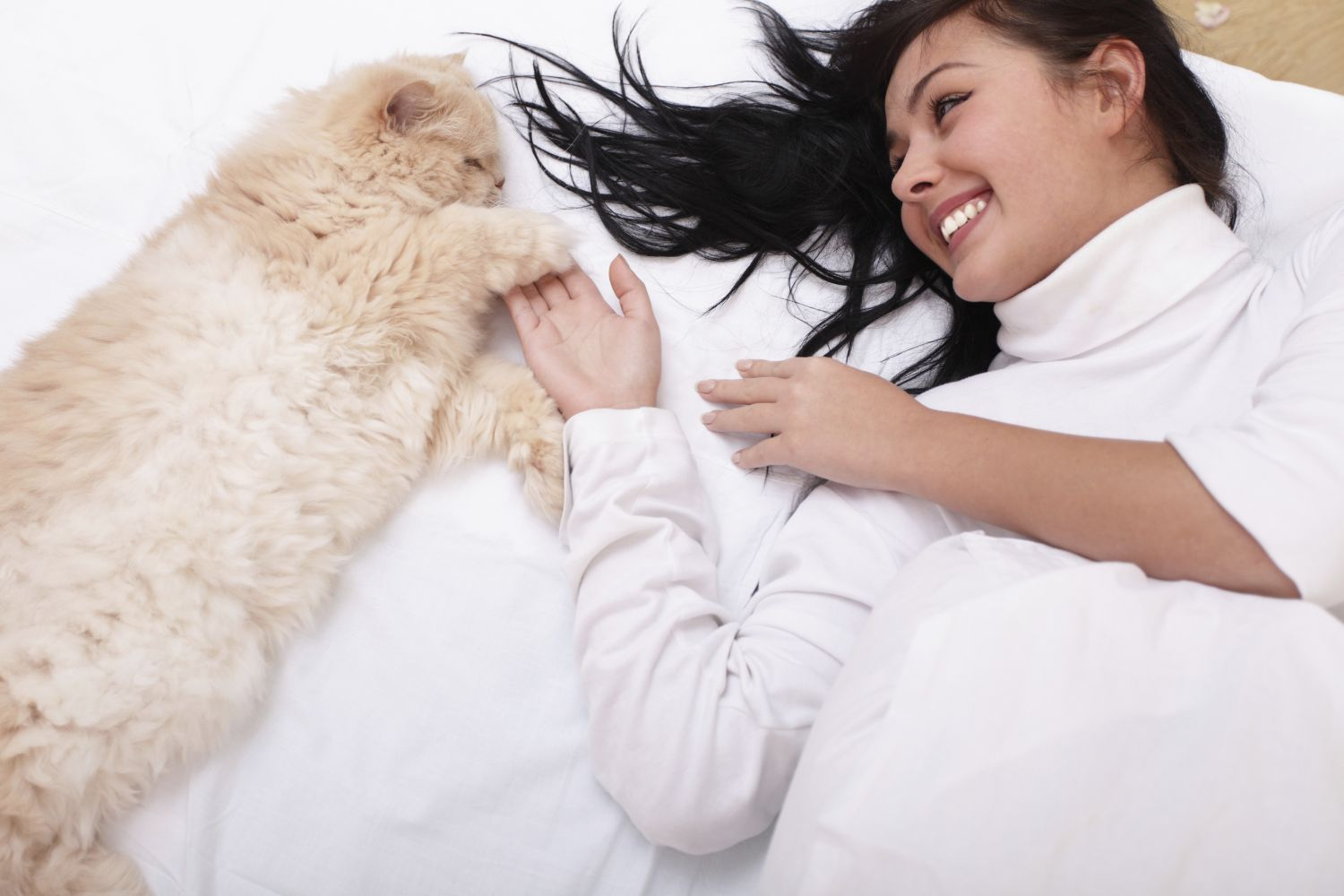 Woman playing with healthy pet after animal vaccinations in Cincinnati, OH