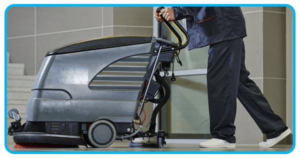 bi commercial cleaning worker cleaning floor using machine